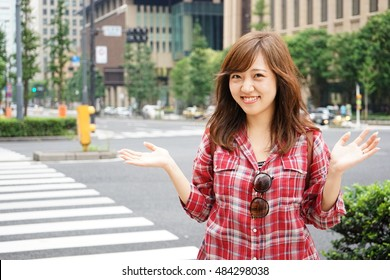 Young Japanese person smiling on the street
