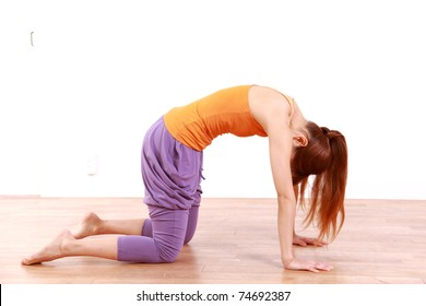 """Young Japanese Woman Doing YOGA """"cat pose"""""""