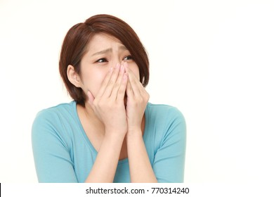 young Japanese woman frightened