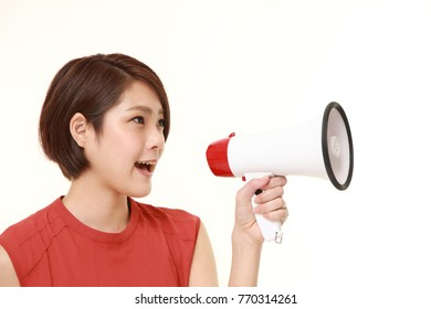 young Japanese woman with megaphone