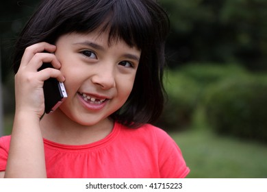Young Japanese-Russian girl talking on a cellphone