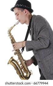 The young jazz man plays a saxophone