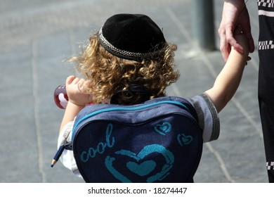 Young Jewish Boy Walking To School with Skullcap
