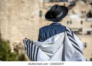 A young Jewish man walking in the streets of Jerusalem