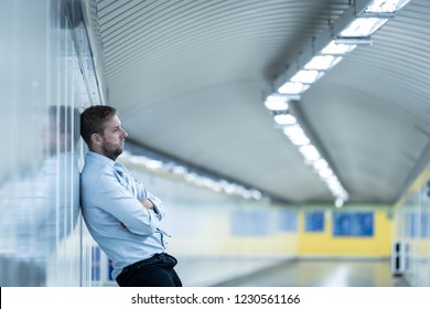 Young jobless business man suffering depression leaning on street underground wall alone looking desperate in Emotional pain Mental health Unemployment Human emotions and sadness concept.