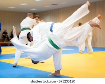 Young judoka throwing his opponent