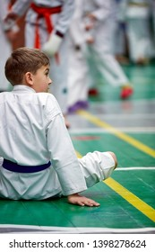 young karate boy warming up in a kimono