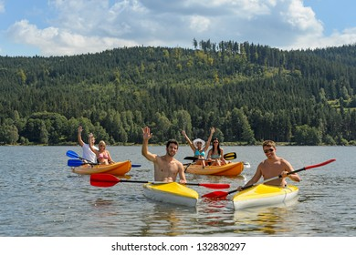 Young kayaking friends having fun in scenic view summer holiday