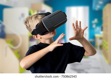 7d89e99ce35f young kid child play VR virtual reality game goggles in room exciting new  computer smartphone