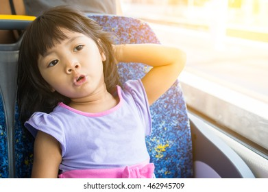 Young kid enjoy relax sitting on the train on a sunny day
