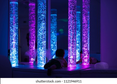 Young kid exploring a multi sensory space - snoezelen concept