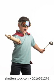 Young kid playing with kitchen tools
