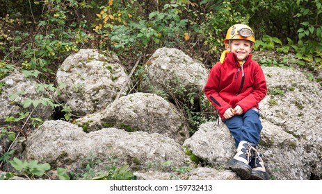 Young kid portrait with helmet for cave exploration.