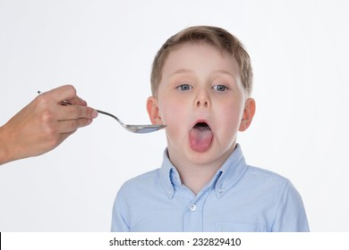 young kid takes syrup with a very bad taste