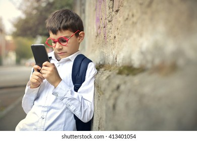 Young kid using his smartphone