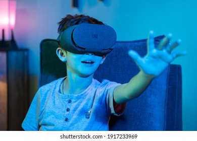 Young kid with VR or virtual reality headset feeling or enjoying the 360 degree virtual environment - Concept of showing futuristic of modern VR technology in modern lifestyle