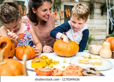 Young kids carving Halloween
