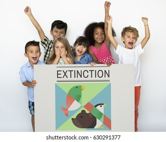 Young kids holding a save the animals banner