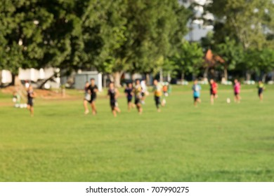 Young kids playing a soccer training match field.