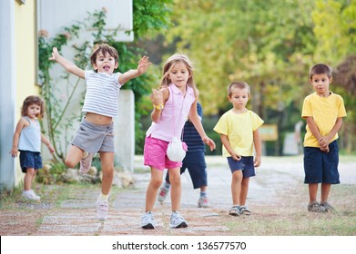 Young kids playing together outdoors.