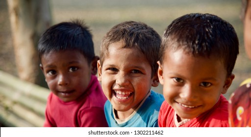Young kids smiling together sitting in a place