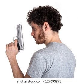 Young killer with gun portrait over white background.