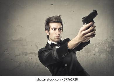 Young killer pointing a gun