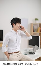 Young Korean businessman talking on the phone
