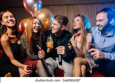 young ladies and guys chilling and rocking in karaoke bar, spend day-off in karaoke together with friends, enjoy time in club