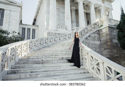 young lady in black dress at the entrance of neoclassical building