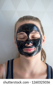 Young lady with black face mask on her face
