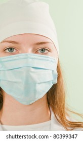 Young lady doctor wearing the mask
