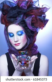 Young lady in doll style with vintage glass box in her hands