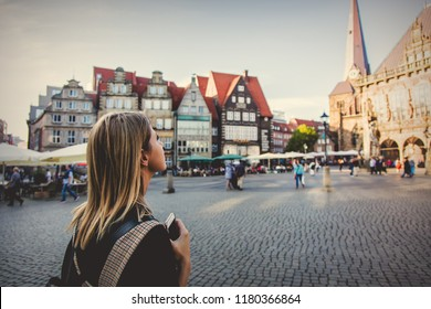 Young lady in dress on medieval street of Bremen, Germany. Trevel destination concept