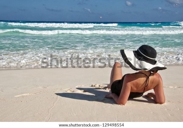 young lady enjoying some quiet time on the beach