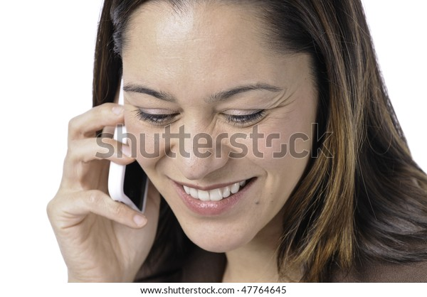 Young lady of filipino ethnicity,is sitting on stool with a white background.She listening on the telephone.With a smile on her face.