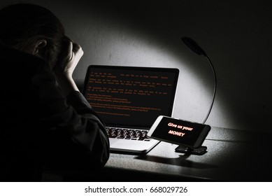 Young lady frustrated, confused and headache by Petya ransomware attack on desktop screen, notebook and smartphone, cyber attack internet security concept