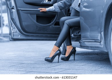 Young lady get out of the car