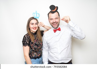 young lady girl man pose photo booth props smiling laugh happy bow crown