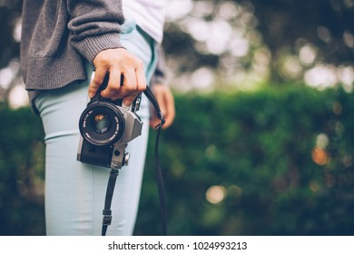Young lady holding a film slr camera