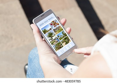 Young lady holding smartphone, with  pictures of hotels and resorts, outdoor  on a sunny day, planning vacation, booking travel.
