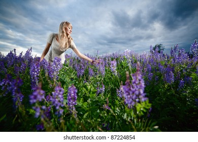 Young lady in a lavender field - wide-angle shot