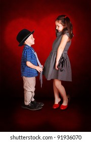 Young lady and little gentleman confession in love at the burgundy background