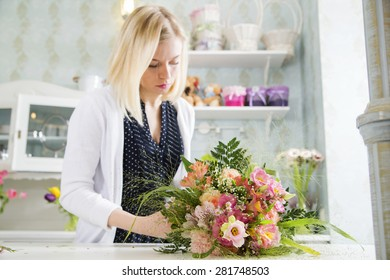 Young lady looks at her new bouquet
