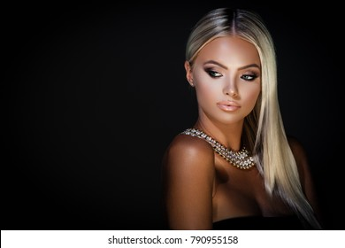 Young lady with luxury accessories on dark background