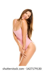 Young lady in one piece swimsuit and long hair posing on white background
