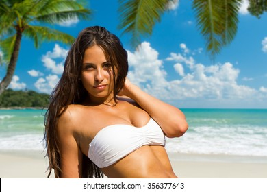 YOung  lady is relaxing on a tropical beach