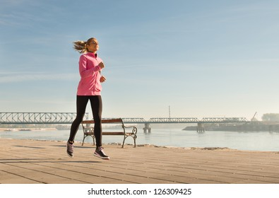young lady running outside on sunny day