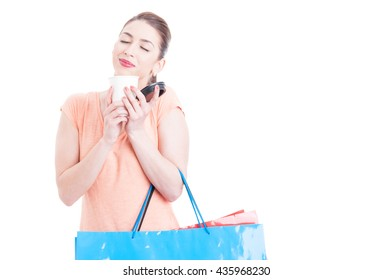 Young lady at shopping having and enjoying a coffee break concept isolated on white with copy space text area