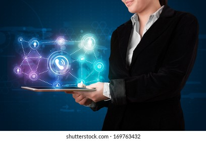 Young lady showing social networking technology with colorful lights